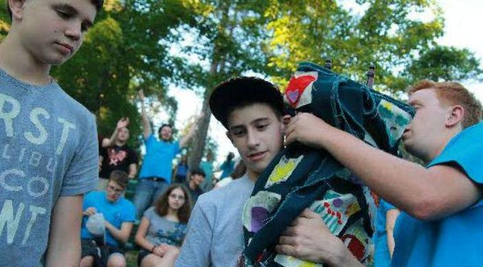 Teens at Reform Jewish summer camp carrying the Torah