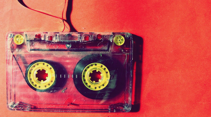 Red cassette tape lightly unspooling