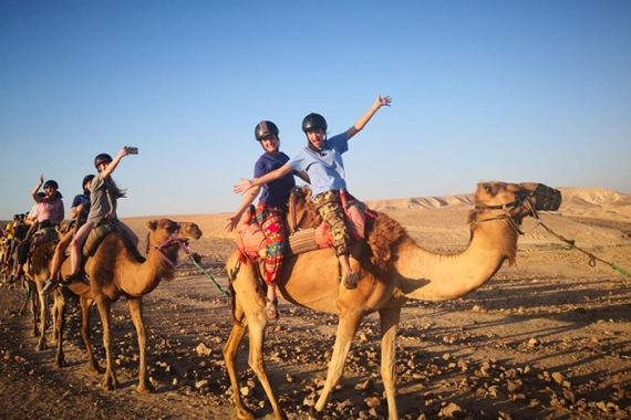 NFTY in Israel participants riding camels
