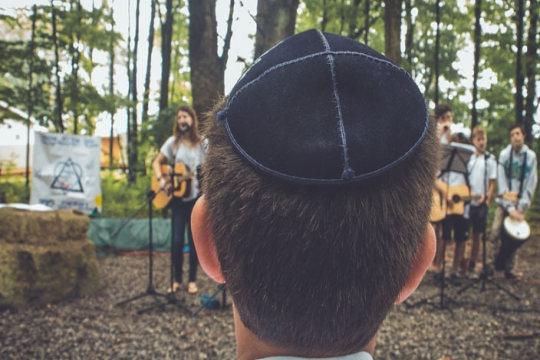 a Boy at Jewish summer camp wearing a kippah or yarmulke