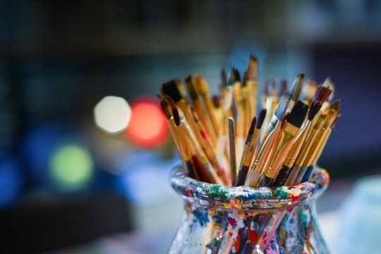 Paintbrushes in a glass vase