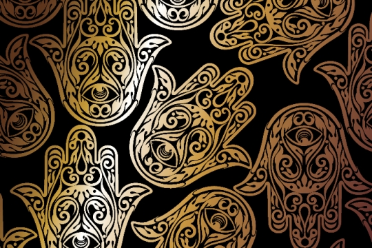 Ornate gold hamsas on a black background