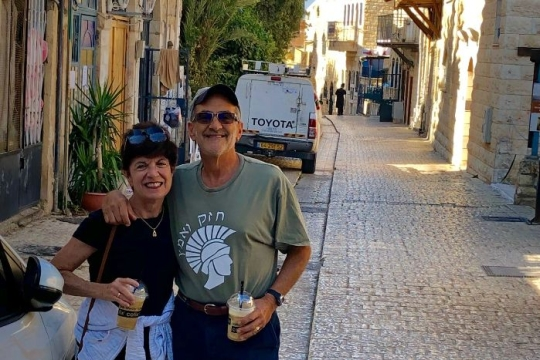Marc and Karen Rivo smiling in the streets of Safed