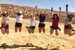 students joyously jumping in the air during a NFTY in Israel trip